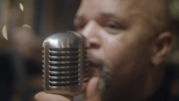 Hand-held shot of a man singing into a microphone Royalty-free stock video