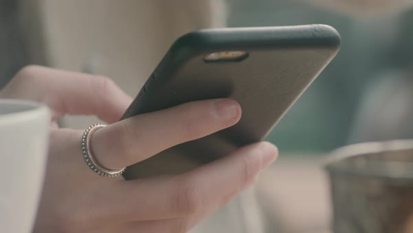 Hand-held shot of a woman using a smartphone Royalty-free stock video