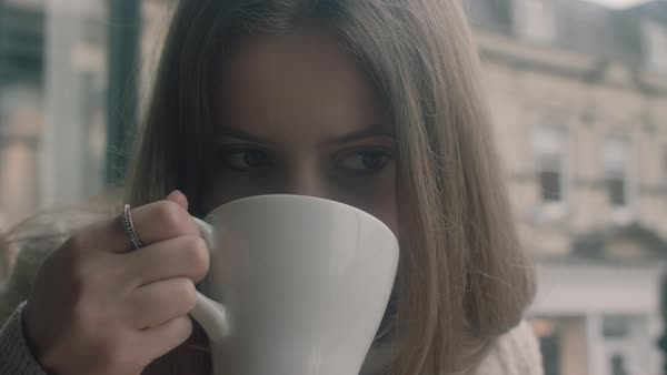 Slow motion of a woman drinking from a mug Royalty-free stock video