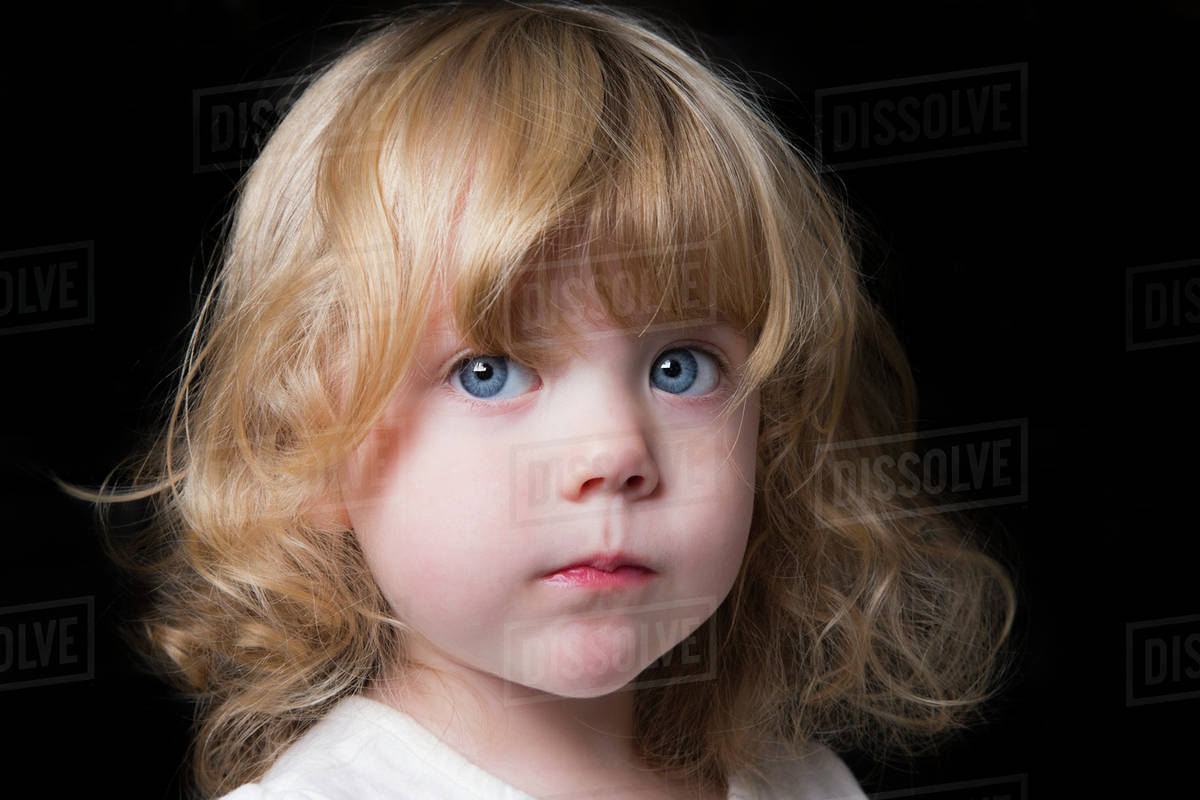 Portrait Of A Beautiful Young Girl With Huge Blue Eyes And Curly Blond Hair On A Black Background Spruce Grove