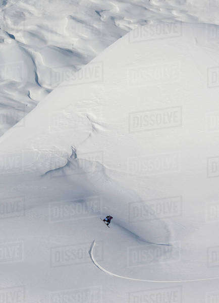 Snowboarding on a snow covered slope; Haines, Alaska, United States of America Royalty-free stock photo