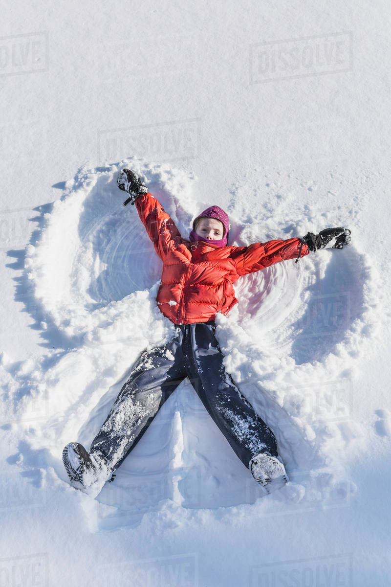 Young Girl Making A Snow Angel In Wintertime Talkeetna Alaska United States Of America Stock Photo