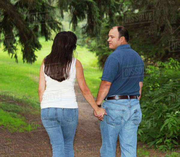Married couple walking in a park spending quality time together; Edmonton, Alberta, Canada Royalty-free stock photo