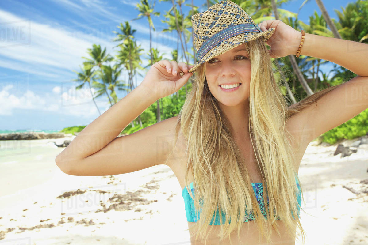 72a00f5320 A teenage girl on the beach in a two piece bathing suit and hat;Maui hawaii  united states of america