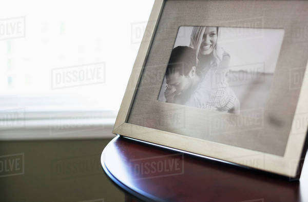 A frame picture of a couple on a table; British Columbia, Canada Royalty-free stock photo