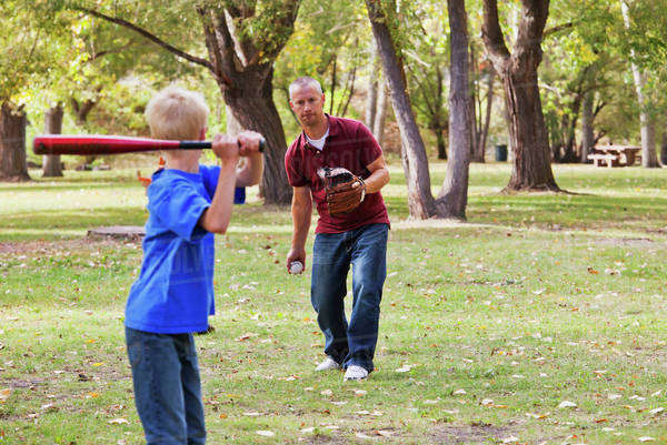 Father And Son Playing Baseball In A Park; Edmonton, Alberta, Canada Royalty-free stock photo