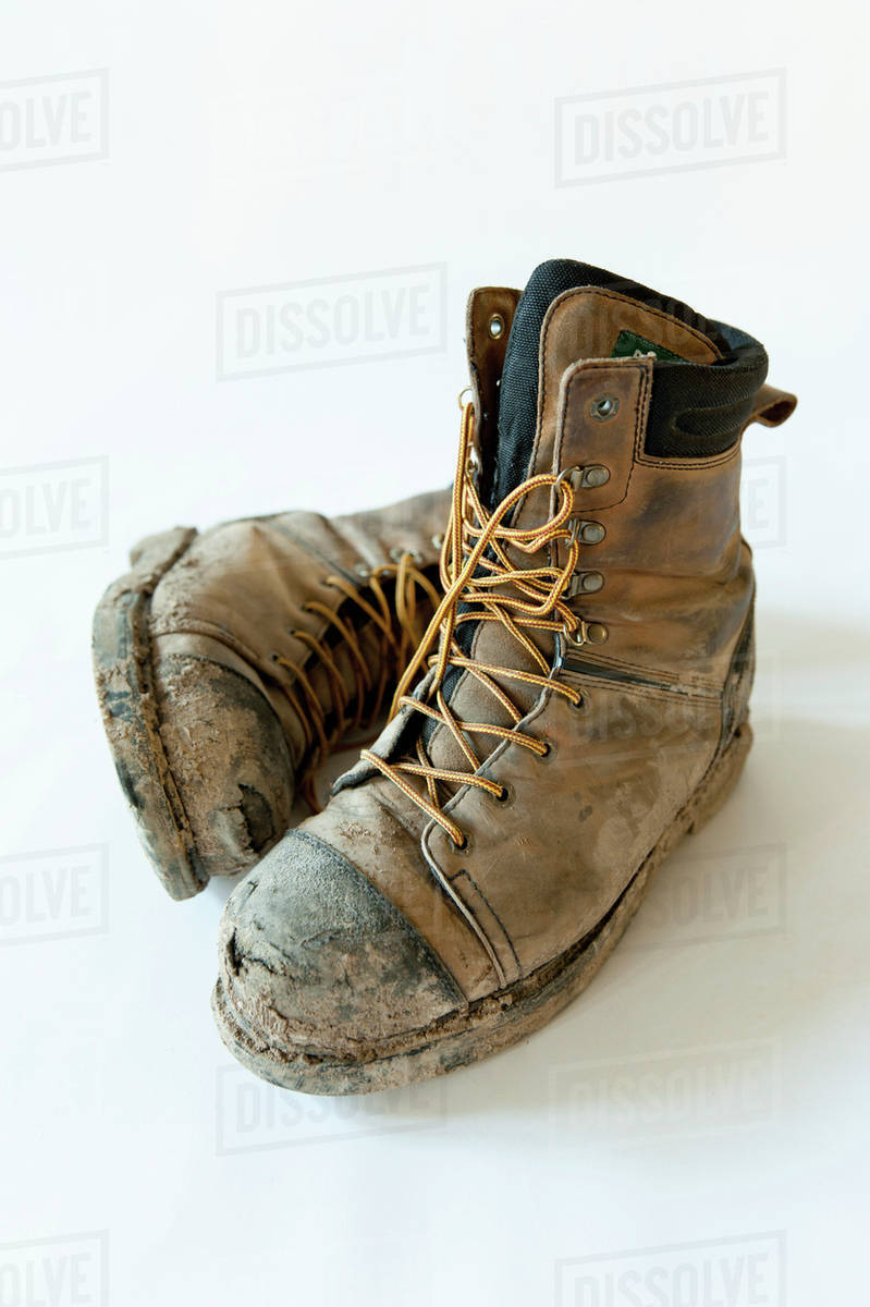 10ffcf9d9e1 Dirty And Broken In Construction Work Boots; Edmonton, Alberta, Canada  stock photo