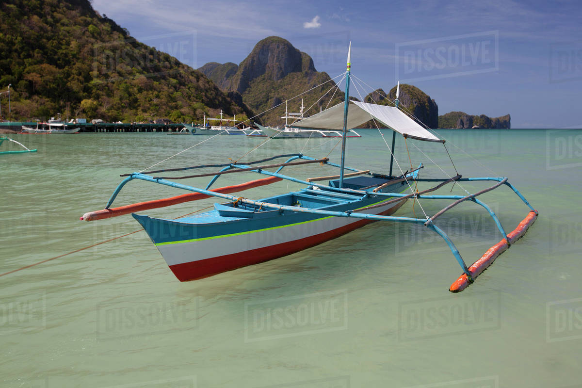 bangka boats sit in the picturesque and scenic bay el nido bacuit