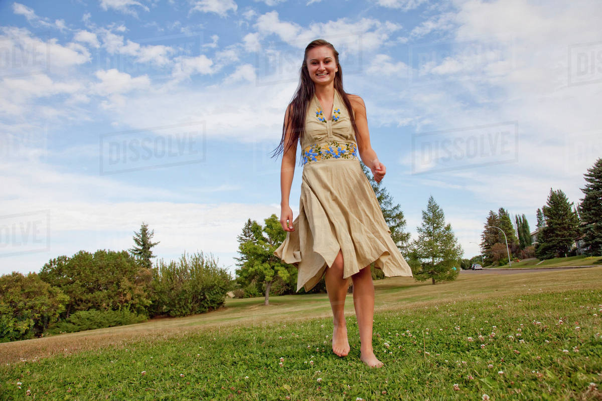 4ca17829808ec A Young Woman Dancing In A Park With A Flowing Dress; Edmonton, Alberta,  Canada