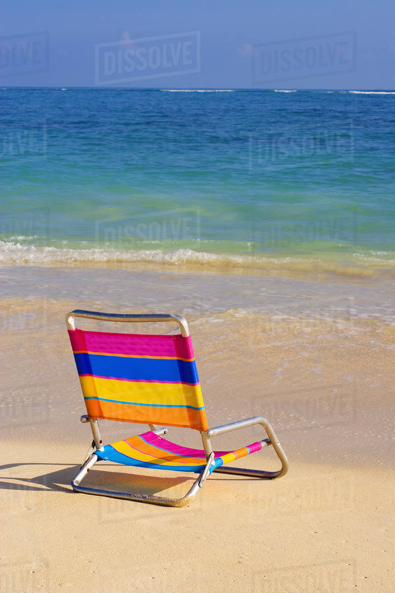 Colorful Beach Chair On The Sline Of A Tropical Calm Waves Washing As Turquoise Water
