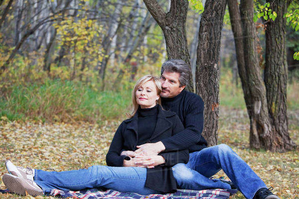 Couple Spending Quality Time Together In A Park In Autumn; St. Albert, Alberta, Canada Royalty-free stock photo
