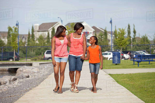 Mother And Daughters Walking In A Residential Lake Area; Edmonton, Alberta, Canada Royalty-free stock photo