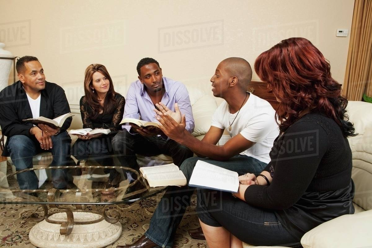 A Group Of Adults In A Home Bible Study stock photo