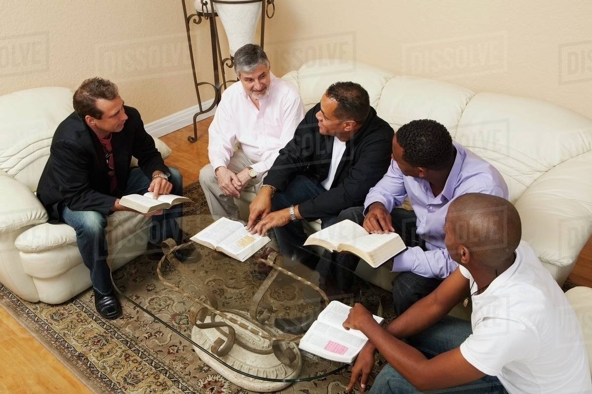 A Group Of Men In A Home Bible Study stock photo