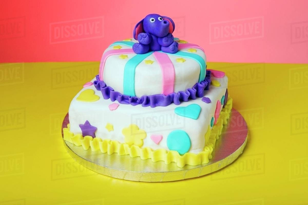 Cool A Childrens Birthday Cake With A Blue Elephant On Top Stock Funny Birthday Cards Online Alyptdamsfinfo