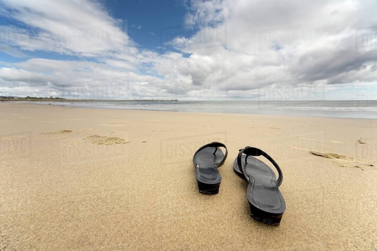 2976988d2 Sandals On The Beach - Stock Photo - Dissolve