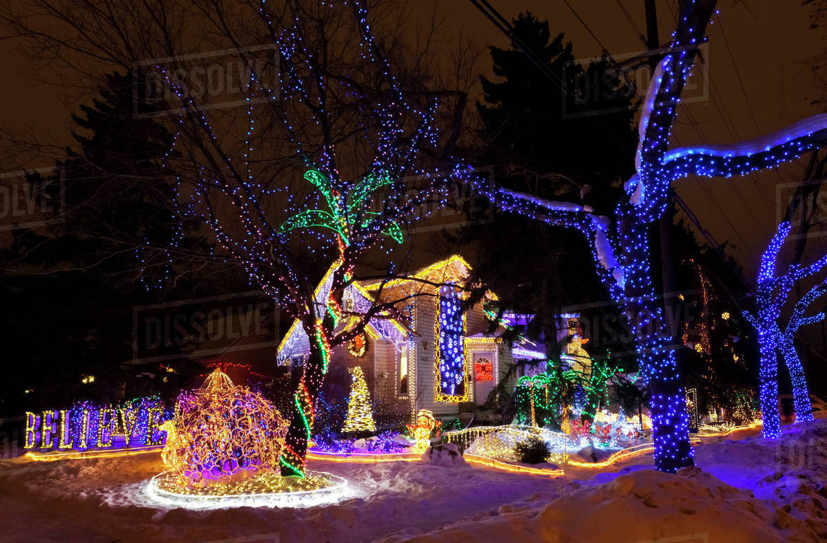 colourful christmas light display in a residential front yard edmonton alberta canada