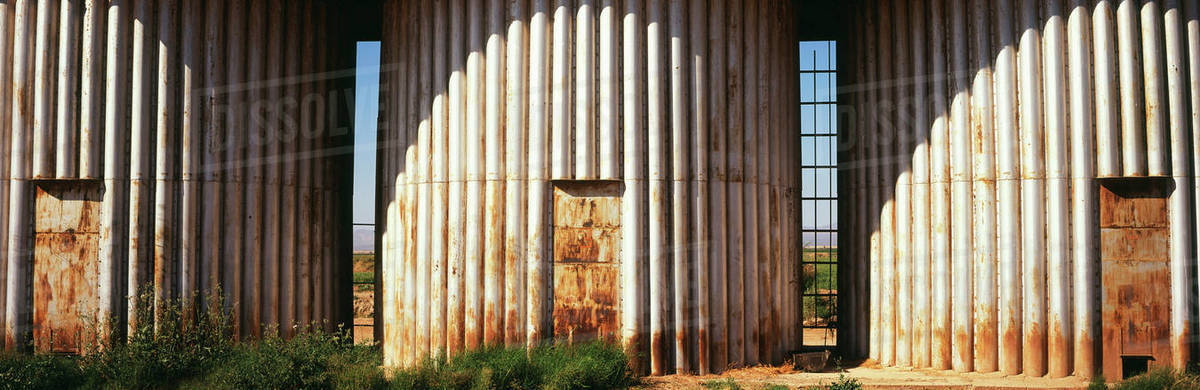 A close up view of three rusted grain silos in Coachella Valley