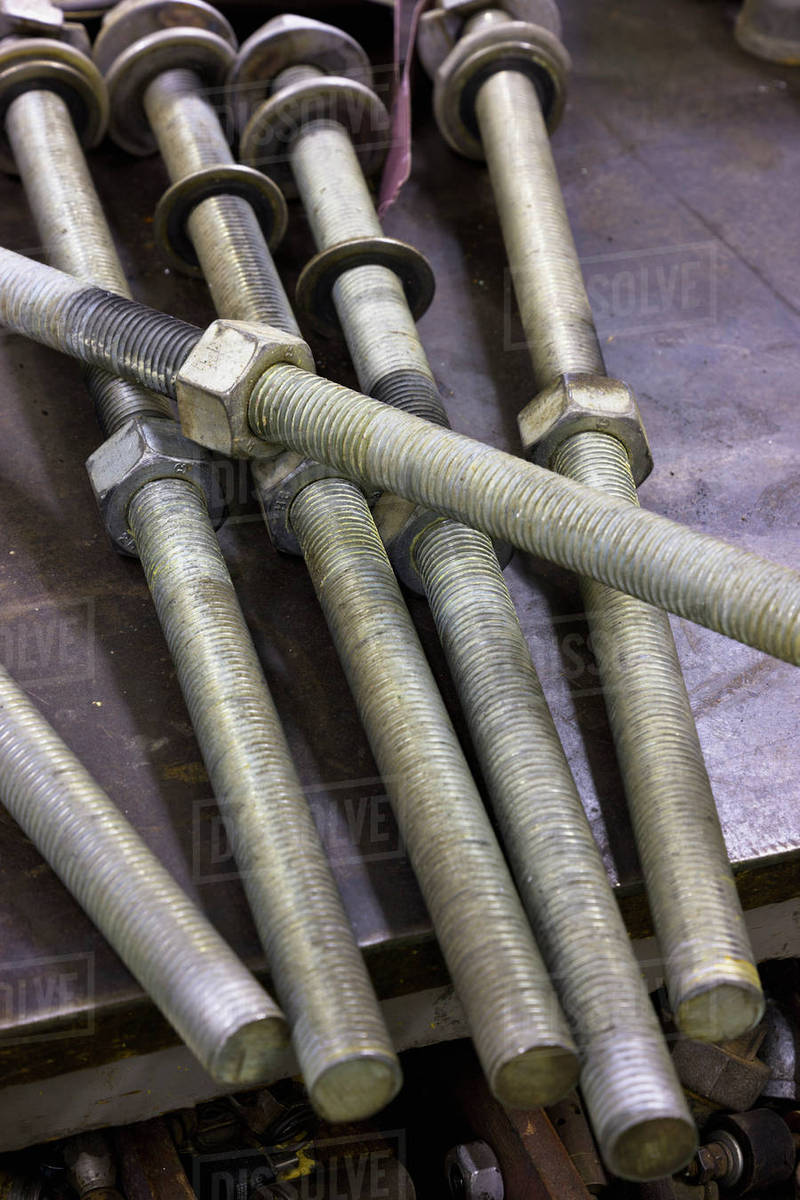 Close up of large bolts with nuts at an electrical power plant, Sand Point,  Southwestern Alaska, USA stock photo