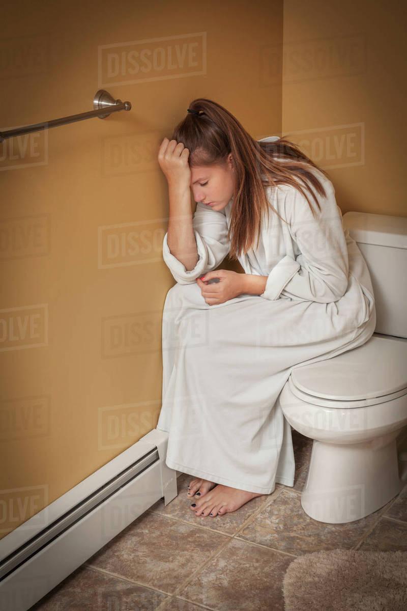 Teenage Girl Sitting In The Bathroom On, Teen In Bathroom