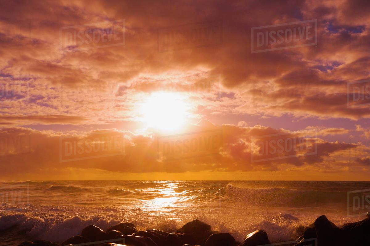 Sunrise and waves crashing on the rocks, Kealia Beach