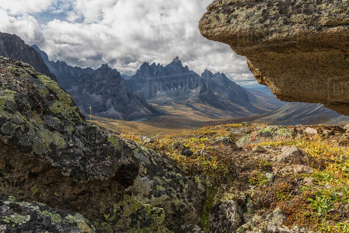 Tombstone Mountain is framed by rocks in this view within Tombstone ...