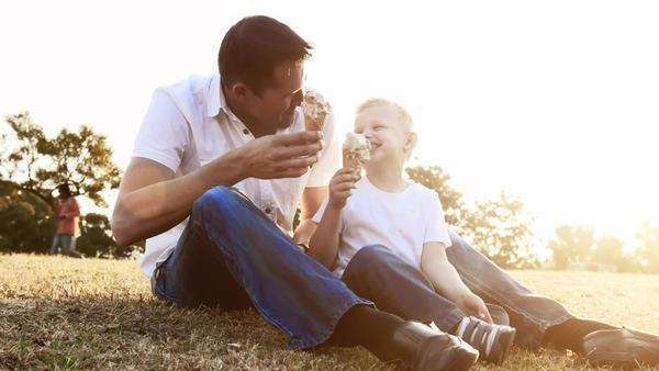 Father and son eating ice cream, steadicam shot. Royalty-free stock video