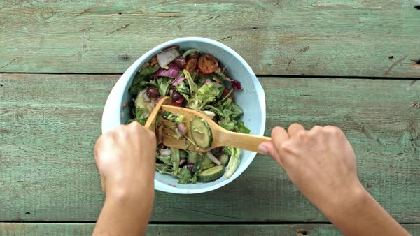 Woman's hands tossing a salad. Royalty-free stock video