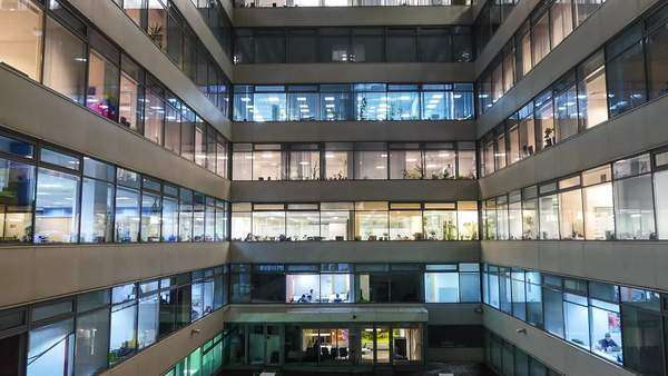 Zoom out time lapse of busy city office workers together in large modern office building Royalty-free stock video