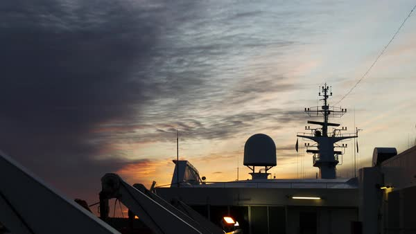 Cruise ship radar surrounded by a set of antennas, sunset Royalty-free stock video