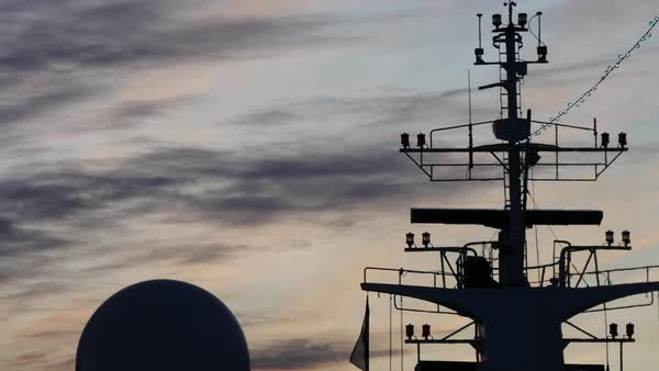 Ferry boat radar surrounded by a set of antennas, sunset Royalty-free stock video