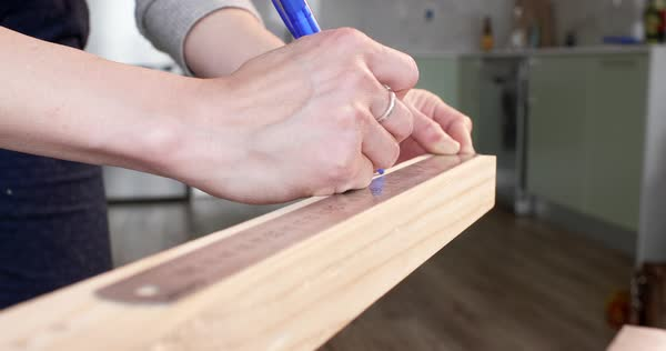 Home diy woman measuring wood for carpentry work Royalty-free stock video