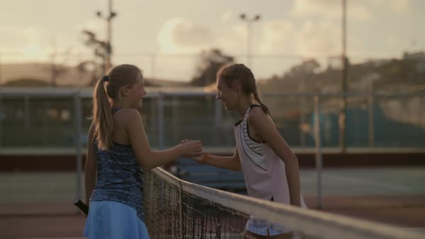 Competitors opponents shake hands after their tennis match game, display of sportsmanship and friendship Royalty-free stock video