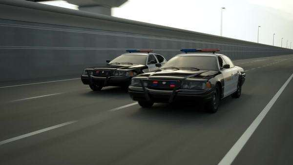 Police cars in speed travelling on road Royalty-free stock video