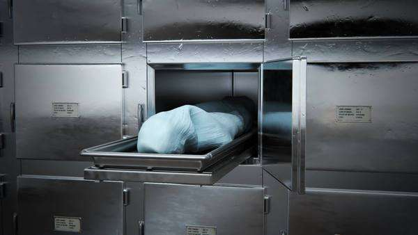 Dead body covered with cloth in morgue Royalty-free stock video