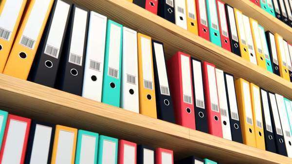 Close-up of colorful file binders on shelf in office Royalty-free stock video