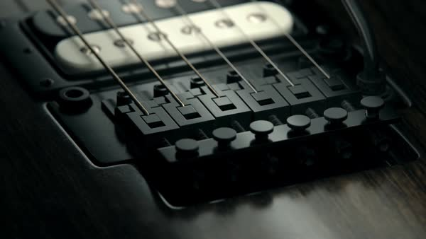 Details of six-string electric guitar. tailpiece pickup strings Royalty-free stock video