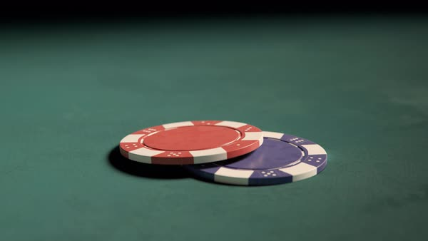Two casino chips falling on a table Royalty-free stock video