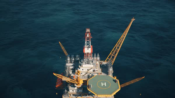 Aerial view of the offshore drilling oil rig in the middle of the sea. Royalty-free stock video