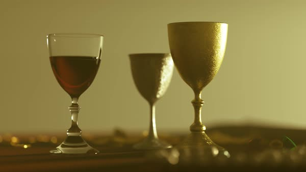 Shot with camera slide near wooden table with goblets and jewels on it. Royalty-free stock video