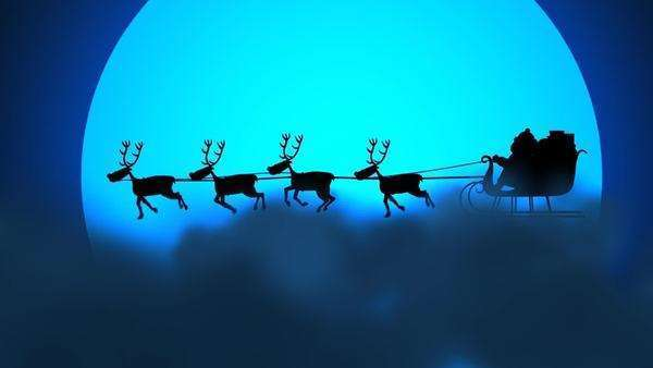 Silhouette Of Santa Riding On Reindeer Sledge With The Moon In The Background Royalty-free stock video