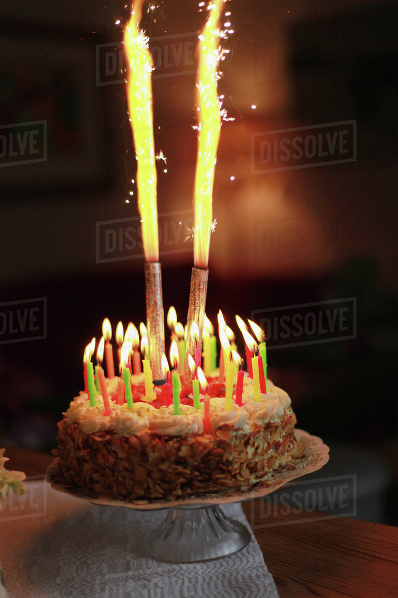 Excellent Sparkler Candles Burning On Dried Food Cake Stock Photo Dissolve Funny Birthday Cards Online Alyptdamsfinfo