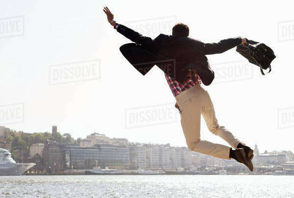 Excited businessman jumping in air Royalty-free stock photo