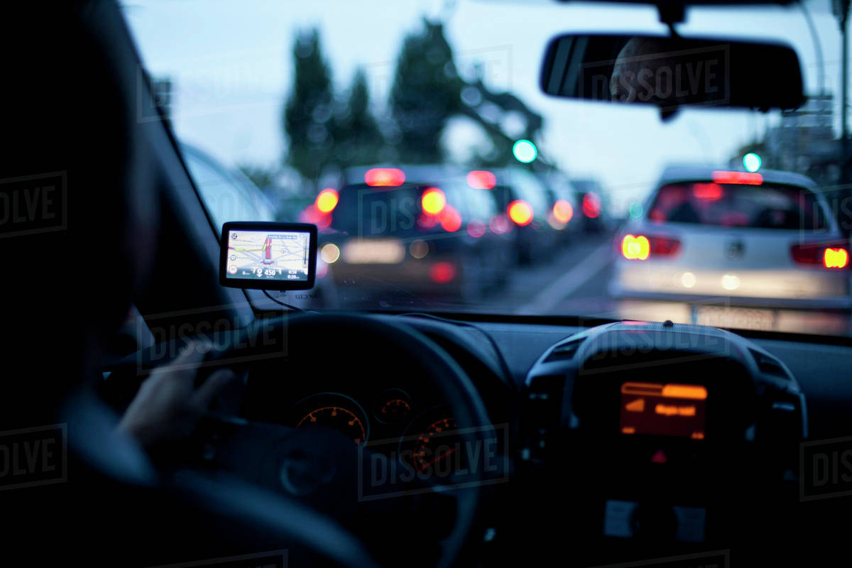 Person Using Navigator Inside Car During Road Trip Stock Photo Dissolve