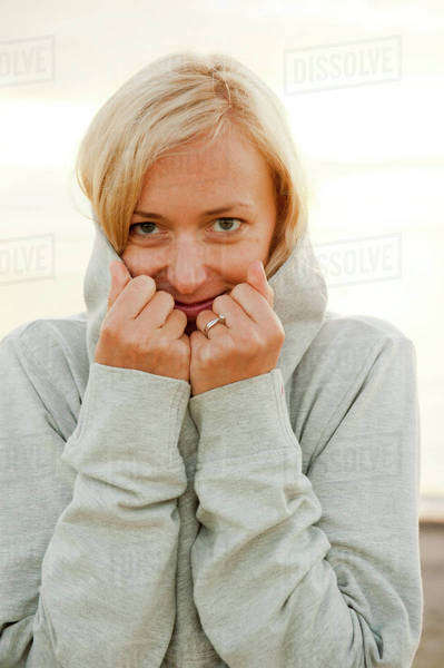 Portrait of happy young woman in hood jacket Royalty-free stock photo