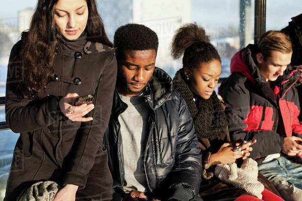 Group of multi ethnic friends using mobile phones Royalty-free stock photo