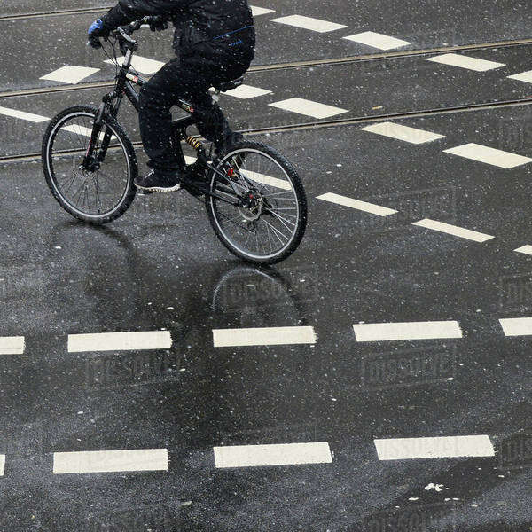 Low section of person cycling on street with markings Royalty-free stock photo