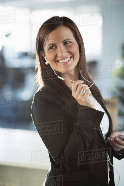 Happy businesswoman talking on headphones in office Royalty-free stock photo