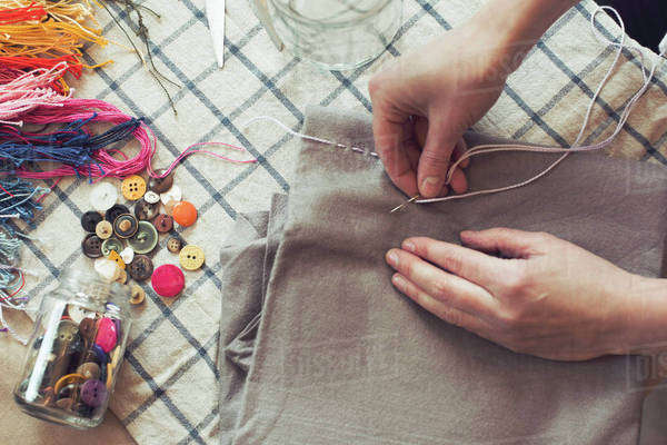 High angle view of woman stitching fabric on table at home Royalty-free stock photo