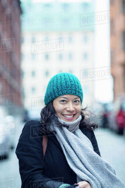 Portrait of happy woman in city street Royalty-free stock photo